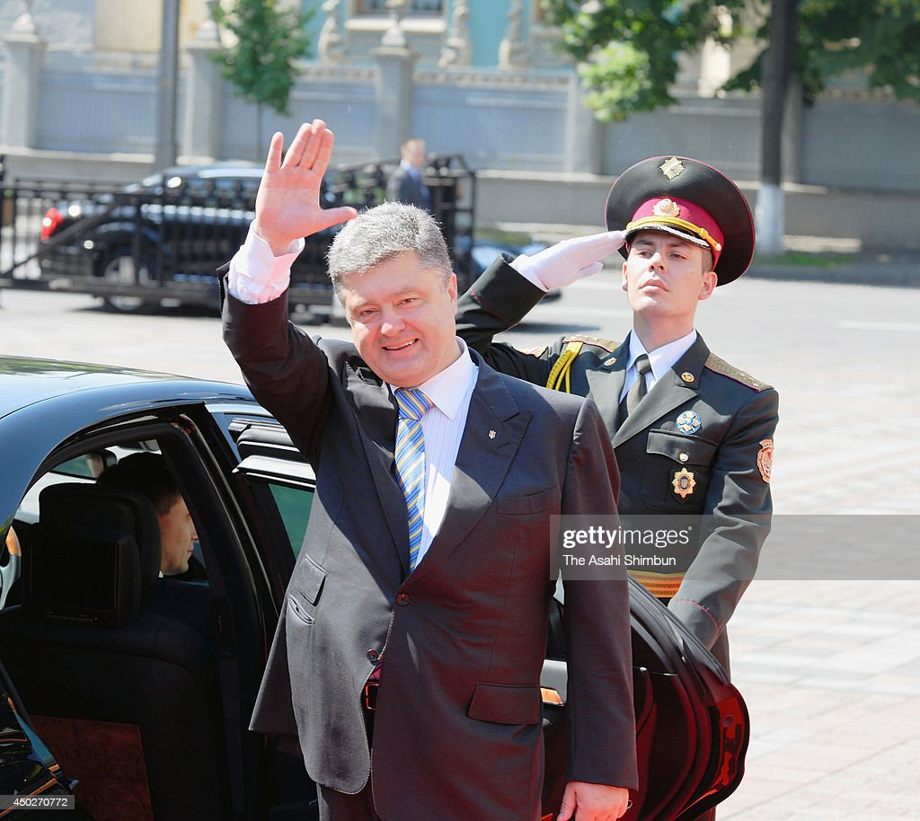 Ukraine's new president, <a gi-track='captionPersonalityLinkClicked' href=/galleries/search?phrase=Petro+Poroshenko&family=editorial&specificpeople=549382 ng-click='$event.stopPropagation()'>Petro Poroshenko</a> (C), takes part in inaugural festivities at St. Sophia Square on June 7, 2014 in Kiev, Ukraine. Poroshenko was elected on May 25 with a majority in the country's first round of presidential voting.