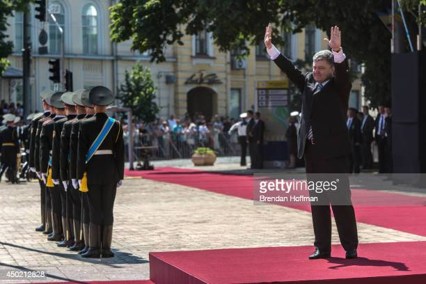 Ukraine's new president Petro Poroshenko waves during inaugural festivities on June 7 2014 in Kiev Ukraine Poroshenko was elected on May 25 with a...