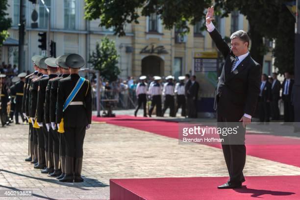 Ukraine's new president Petro Poroshenko waves during inaugural festivities on June 7 2014 in Kiev Ukraine Poroshenko was elected on May 25 with a...