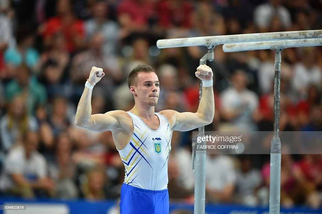 Ukraine's Oleg Verniaiev performs during the Mens Parallel Bars competition of the European Artistic Gymnastics Championships 2016 in Bern, Switzerland on May 28, 2016. / AFP / FABRICE
