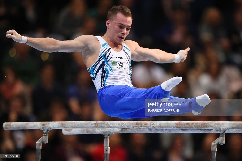 Ukraines Oleg Verniaiev performs during the Mens Parallel Bars competition of the European Artistic Gymnastics Championships 2016 in Bern, Switzerland on May 29, 2016. / AFP / FABRICE