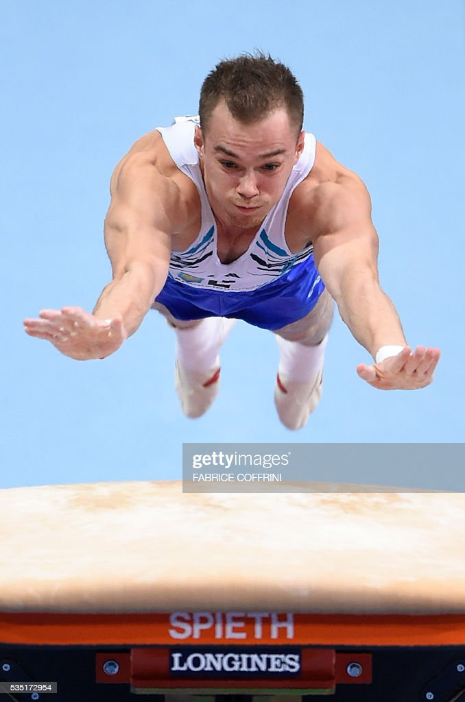 Ukraines Oleg Verniaiev performs during the Mens Vault competition of the European Artistic Gymnastics Championships 2016 in Bern, Switzerland on May 29, 2016. / AFP / FABRICE