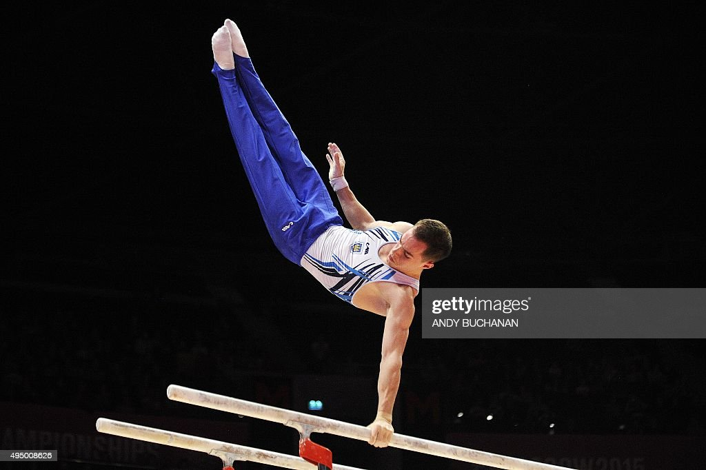 Ukraine's Oleg Verniaiev performs on the parallel bars during the Men's AllAround final during the 2015 World Gymnastics Championship in Glasgow...