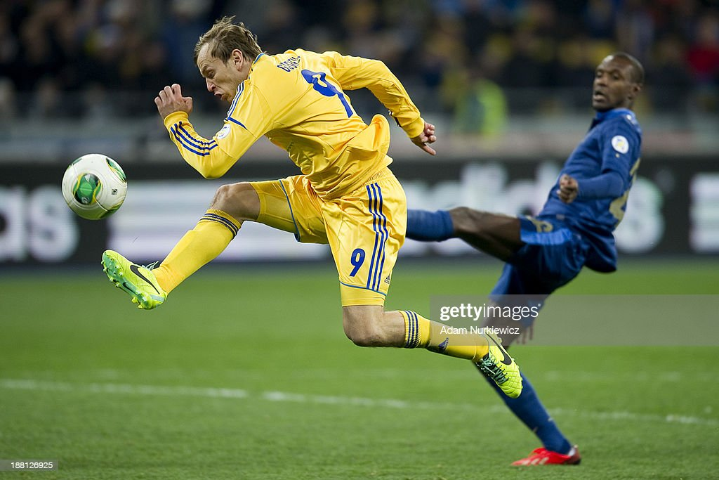 Ukraine's Oleh Gusiev kicks the ball against Eric Abidal of France during the FIFA 2014 World Cup Qualifier Play-off First Leg soccer match between Ukraine and France at the Olympic Stadium on November 15, 2013 in Kiev, Ukraine.