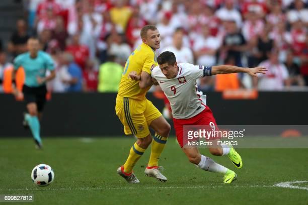 Ukraine's Oleksandr Kucher and Poland's Robert Lewandowski battle for the ball