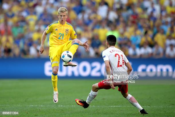 Ukraine's Oleksandr Zinchenko and Poland's Bartosz Kapustka in action