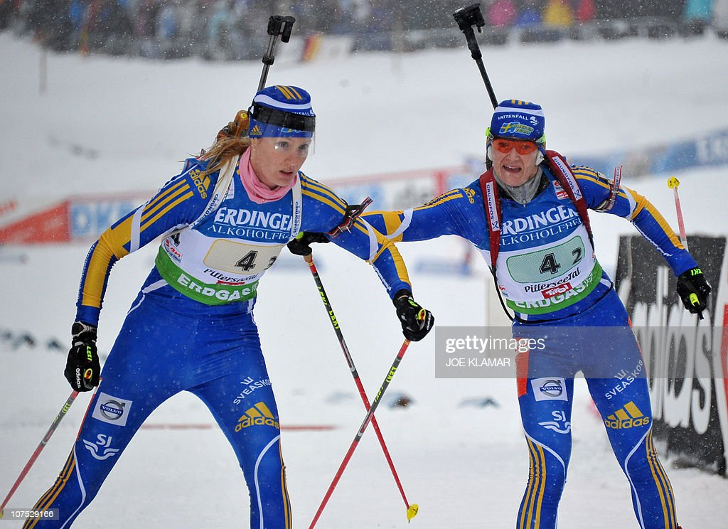 Ukraine's Olena Pidrushna (R) passes over to Vita Semerenko during the women's 4x6 kms relay at the Biathlon World cup in Hochfilzen on December 11, 2010. Germany won ahead of Ukraine and Norway.