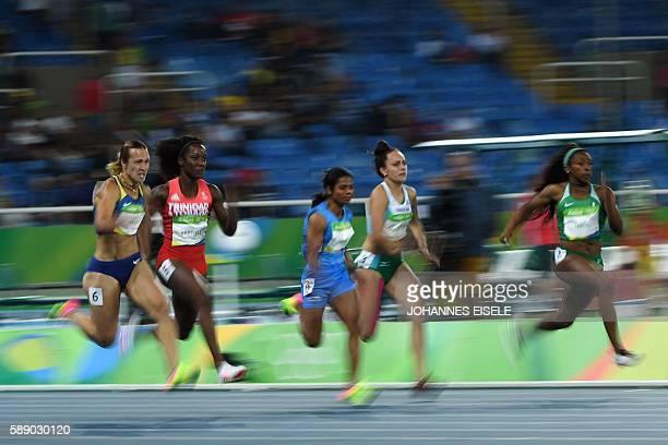 Ukraine's Olesya Povkh Trinidad and Tobago's Kelly Ann Baptiste India's Dutee Chand Uzbekistan's Nigina Sharipova and Nigeria's Jennifer Madu compete...