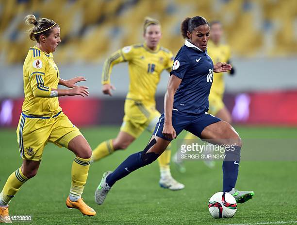 Ukraine's Olha Basanska vies with France's MarieLaure Delie during the Women's EURO 2017 Group 3 qualifying football match Ukraine vs France at Arena...