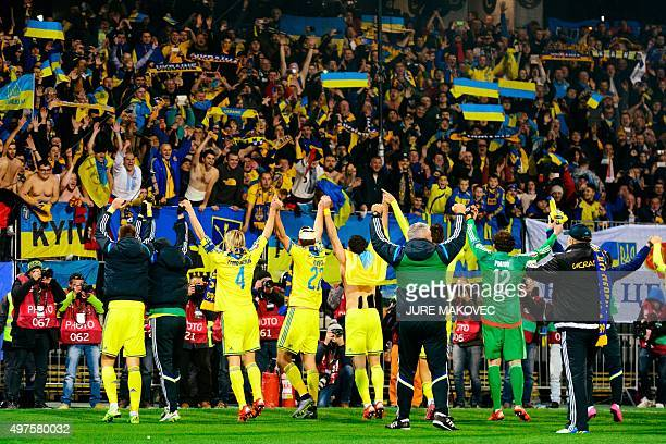 Ukraine's players celebrate after winning the Euro 2016 playoff football match between Slovenia and Ukraine at the Ljudski Vrt stadium in Maribor...