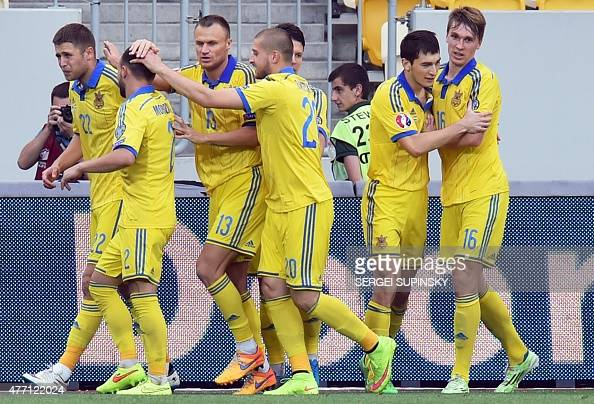 Ukraine's players celebrate scoring a goal during the UEFA Euro 2016 qualifying Group C football match between Ukraine and Luxembourg in Lviv on June...
