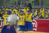 Ukraine's players react after they scored tying goal during the 2012 International Ice Hockey Federation World Championship Div I Group A match...