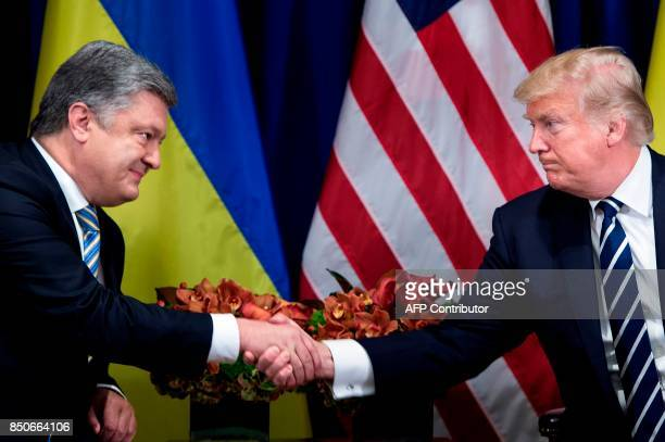 Ukraine's President Petro Poroshenko and US President Donald Trump shake hands before a meeting at the Palace Hotel during the 72nd United Nations...