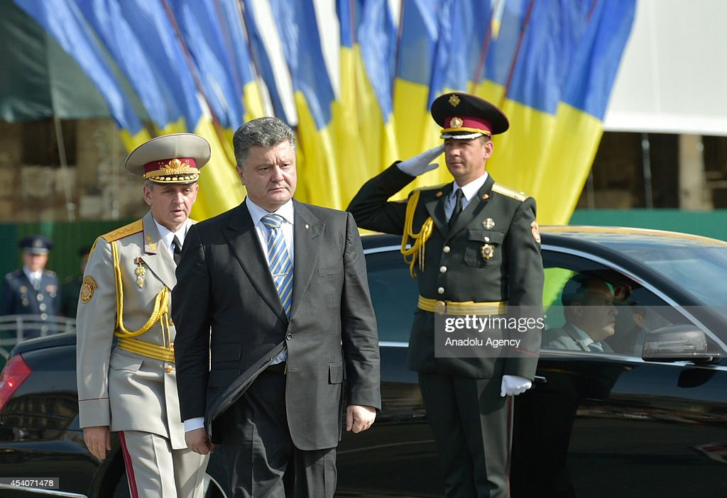 Ukraine's President Petro Poroshenko (C) attends to ceremony marking the 23rd anniversary of Ukraine's independence in Kiev, Ukraine, on August 24, 2014. Ukrainian military forces parade and thousands of Ukrainians attended the celebrations in Kiev's Independence Square, known locally as the 'Maidan'.