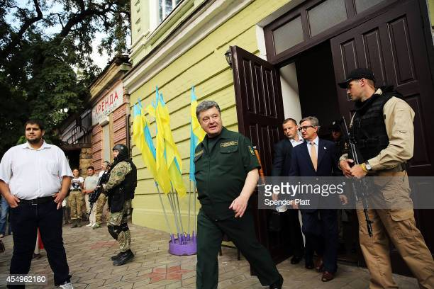 Ukraine's president Petro Poroshenko exits a government building after speaking in the embattled city of Mariupol in the country's east on September...