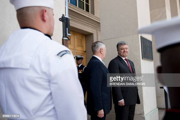 Ukraine's President Petro Poroshenko smiles at US Secretary of Defense James Mattis outside the Pentagon on June 20 2017 in Washington DC / AFP PHOTO...