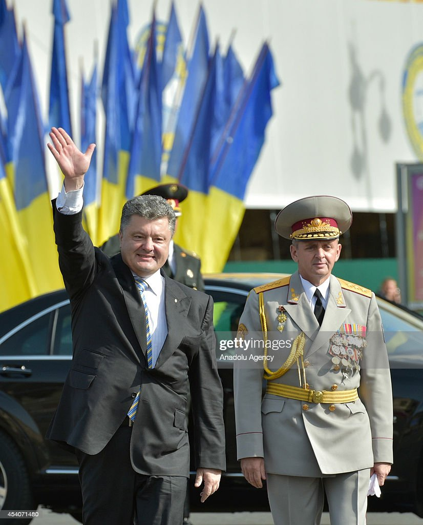 Ukraine's President Petro Poroshenko waves during the ceremony marking the 23rd anniversary of Ukraine's independence in Kiev, Ukraine, on August 24, 2014. Ukrainian military forces parade and thousands of Ukrainians attended the celebrations in Kiev's Independence Square, known locally as the 'Maidan'.
