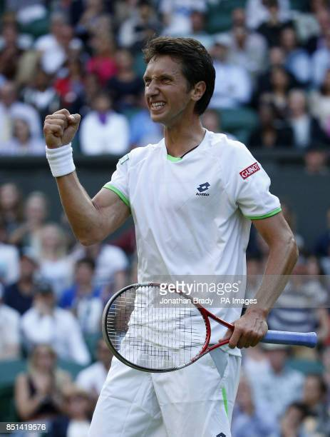 Ukraine's Sergiy Stakhovsky celebrates a point against Switzerland's Roger Federer during day Three of the Wimbledon Championships at The All England...