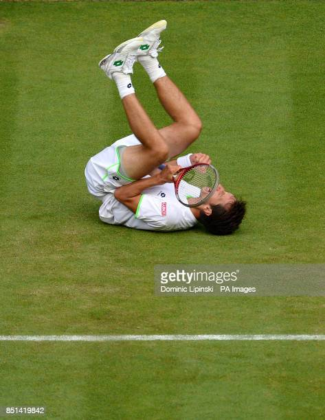 Ukraine's Sergiy Stakhovsky celebrates beating Switzerland's Roger Federer during day Three of the Wimbledon Championships at The All England Lawn...