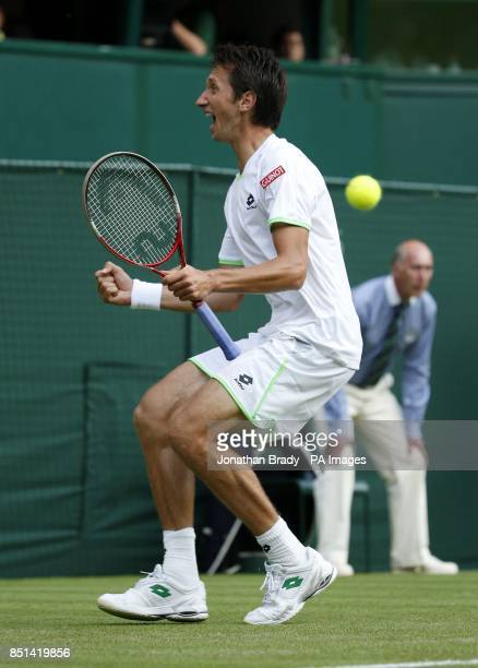 Ukraine's Sergiy Stakhovsky celebrates victory over Switzerland's Roger Federer during day Three of the Wimbledon Championships at The All England...