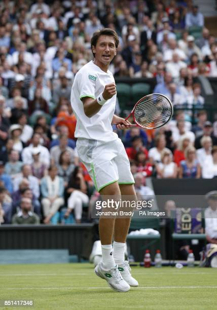 Ukraine's Sergiy Stakhovsky celebrates winning the second set over Switzerland's Roger Federer during day Three of the Wimbledon Championships at The...