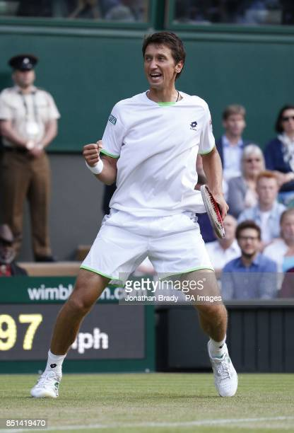 Ukraine's Sergiy Stakhovsky celebrates winning the third set against Switzerland's Roger Federer during day Three of the Wimbledon Championships at...