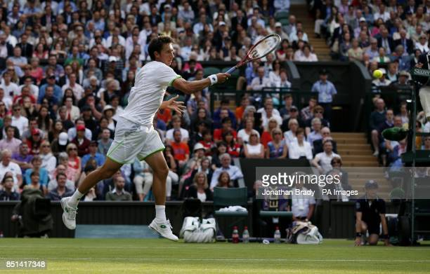 Ukraine's Sergiy Stakhovsky in action against Switzerland's Roger Federer during day Three of the Wimbledon Championships at The All England Lawn...