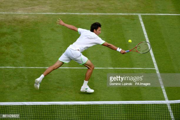Ukraine's Sergiy Stakhovsky in action against Switzerland's Roger Federer