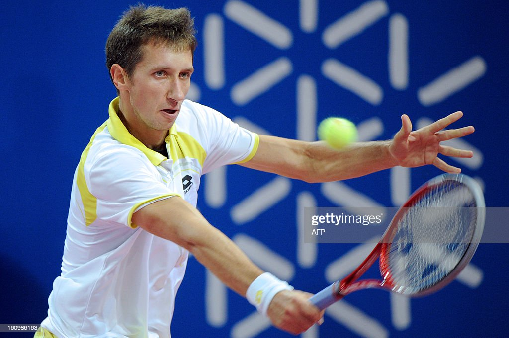 Ukraine's Sergiy Stakhovsky returns the ball to his opponent Jarkko Nieminen of Finland during the Open Sud de France world tour ATP Series quarter final tennis match on February 8, 2013 in Montpellier southern France. Nieminen won the match. AFP PHOTO / SYLVAIN THOMAS