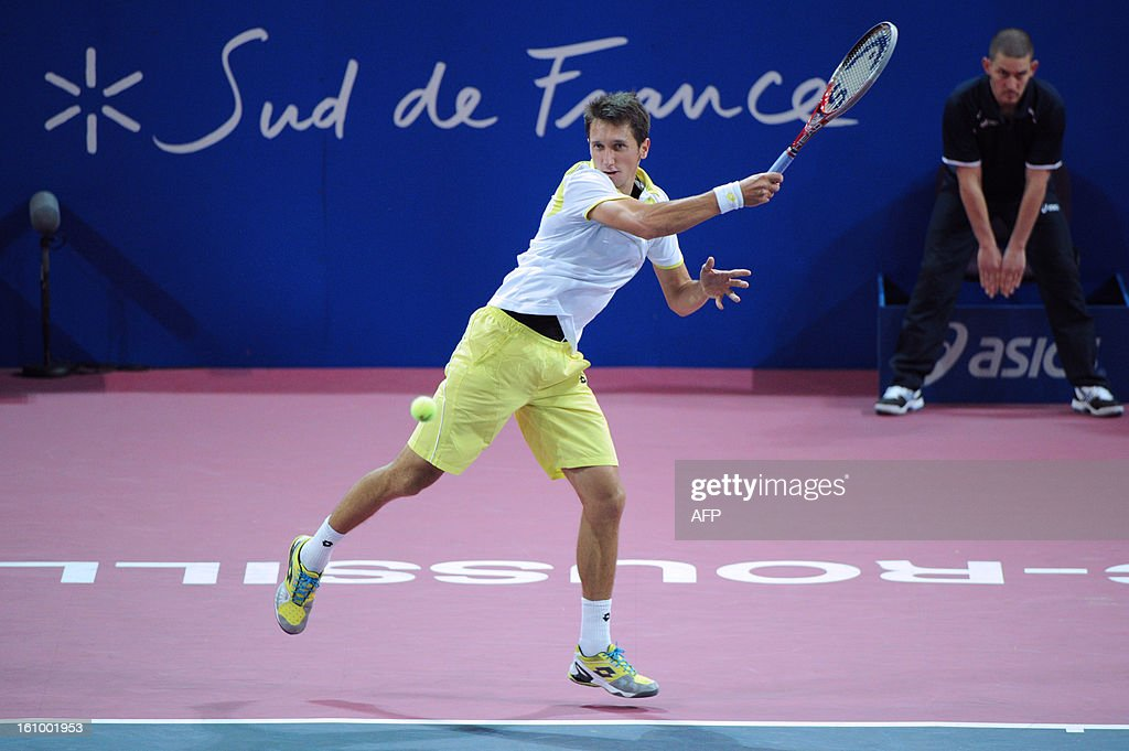 Ukraine's Sergiy Stakhovsky returns the ball to his opponent Jarkko Nieminen of Finland during the Open Sud de France world tour ATP Series quarter final tennis match on February 8, 2013 in Montpellier southern France. Nieminen won the match.