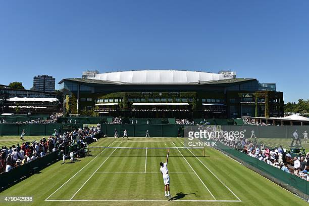 Ukraine's Sergiy Stakhovsky serves against Croatia's Borna Coric during their men's singles first round match on day two of the 2015 Wimbledon...