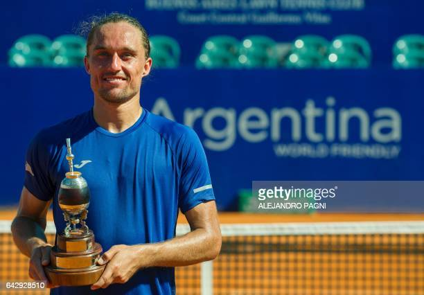 Ukraine's tennis player Alexandr Dolgopolov poses with the trophy after defeating Japan's Kei Nishikori 76 64 in the final of the Argentina Open at...