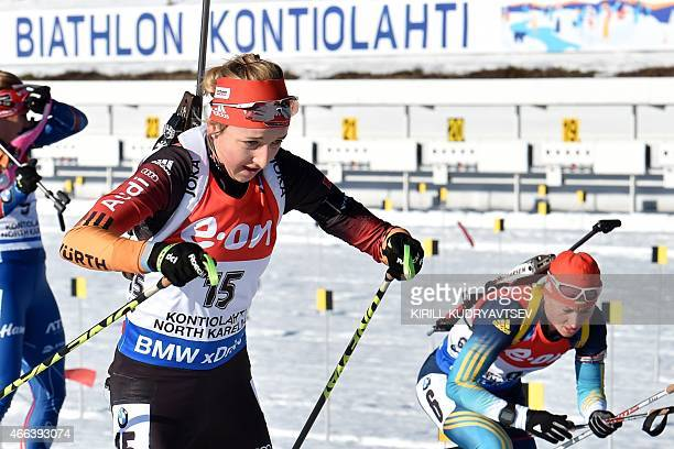 Ukraine's Valj Semerenko and Germany's Franziska Preuss compete during the Women 125 km Mass Start at the IBU Biathlon World Championship in...
