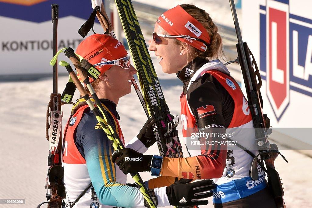 Ukraine's Valj Semerenko (L) and Germany's Franziska Preuss react the Women 12,5 km Mass Start at the IBU Biathlon World Championship in Kontiolahti, Finland on March 15, 2015. Ukraine's Valj Semerenko won the competition, Germany's Franziska Preuss placed second and Italy's Karin Oberhofer placed third.