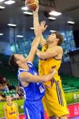 Ukraine's Viacheslav Kravtsov challenges Israel's Yaniv Green during the 2013 EuroBasket Championship match between Ukraine and Israel in Ljubljana...
