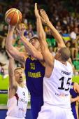 Ukraine's Viacheslav Kravtsov is challenged by Germany's Maik Zirbes and Heiko Schaffartzik during the 2013 EuroBasket Championship group A match...