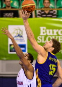 Ukraine's Viacheslav Kravtsov vies with Great Britain's Kieron Achara during a European Championships qualifying Basketball match Great Britain vs...