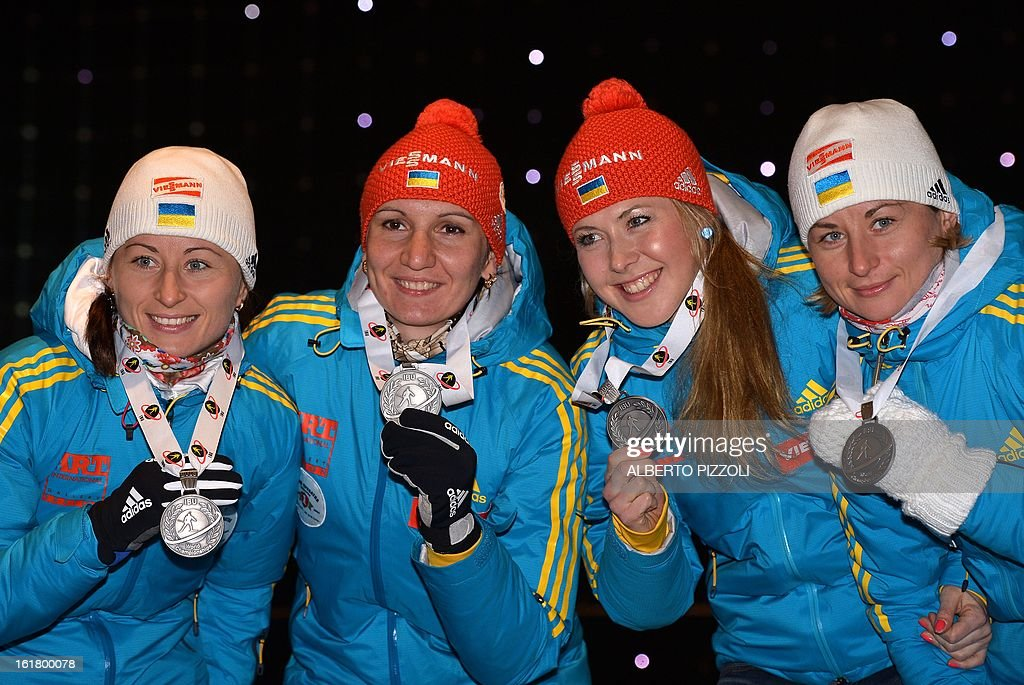 Ukraine's Vita Semerenko, Olena Pidhrushna,Juliya Dzhyma, Valj Semerenko celebrate their silver medals for the women 4x6 Km relay as part of IBU Biathlon World Championships in Nove Mesto, Czech Republic, on February 16, 2013. AFP PHOTO / ALBERTO PIZZOLI