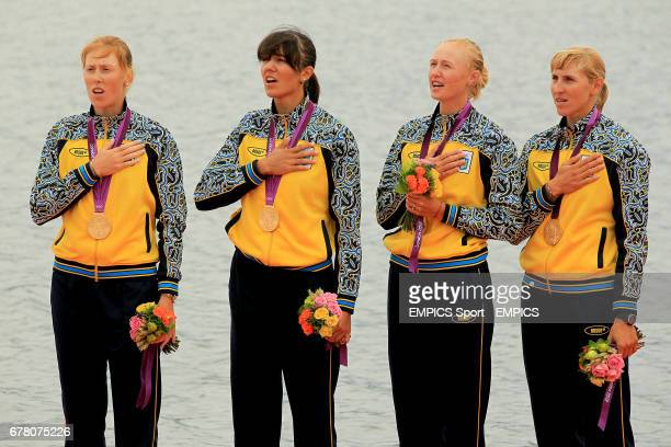 Ukraine's women's quadruple sculls crew of Yana Dementieva Anastasia Kozhenkova Natalia Dovgodko and Kateryna Tarasenko celebrate winning gold in the...