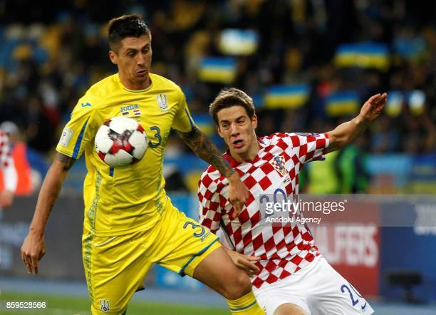Ukraine's Yevhen Khacheridi in action against Croatia's Mario Pasalic during the FIFA World Cup 2018 qualifying soccer match between Croatia and...