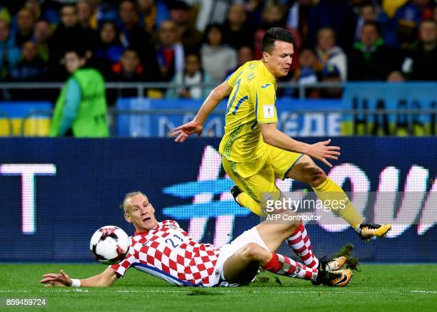 Ukraine's Yevhen Konoplyanka vies with Croatia's Domagoj Vida during the FIFA World Cup 2018 qualification football match between Ukraine and Croatia...