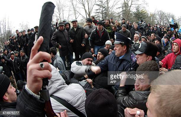 Ukrainian activists clash with proRussian activists as policemen try to separate in front of Crimean regional parliament in Simferopol on February 26...