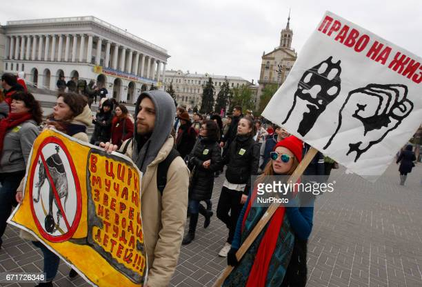 Ukrainian activists with dogs carries posters as they attend the International march for animal rights in center of Kiev Ukraine 22 April 2017