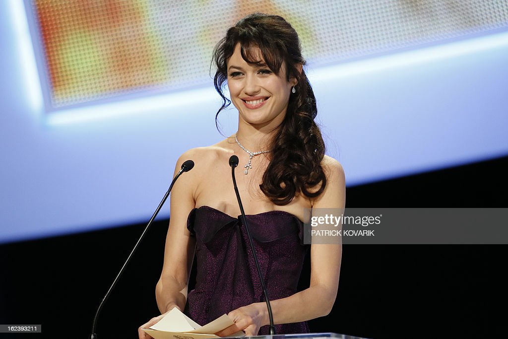 Ukrainian actress Olga Kurylenko unveils the Best Foreign Film award during the 38th Cesar Awards ceremony on February 22, 2013 at the Chatelet theatre in Paris. AFP PHOTO / PATRICK KOVARIK