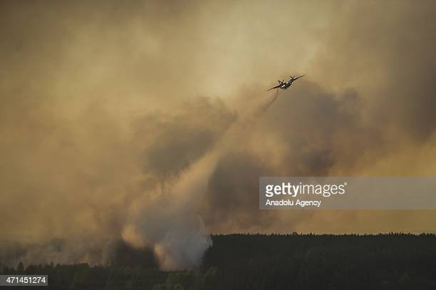 Ukrainian airplane drops water onto a forest fire in the Chernobyl Exclusion Zone near Chernobyl city Ukraine 28 April 2015 A forest fire in northern...