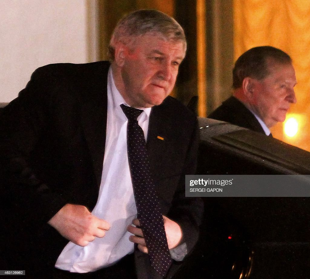 Ukrainian ambassador to Belarus Mykhailo Yezhel (L) and Former Ukrainian President <a gi-track='captionPersonalityLinkClicked' href=/galleries/search?phrase=Leonid+Kuchma&family=editorial&specificpeople=239079 ng-click='$event.stopPropagation()'>Leonid Kuchma</a> arrive on February 10, 2015 in Minsk for talks aimed at ending the bloody conflict in eastern Ukraine ahead of a high-profile summit between Ukraine, Russia, Germany and France.