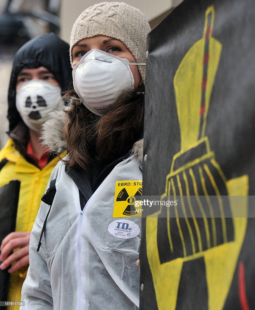 Ukrainian and European Greenpeace activists hold a protest against EBRD financing of Ukrainian nuclear reactors in front of the EBRD bank's representative office in Kiev, on December 7, 2012. Protesters believe the EBRD financial help will enable Ukraine to prolong the operation of the power plants built in the Soviet era increasing their accident risks.