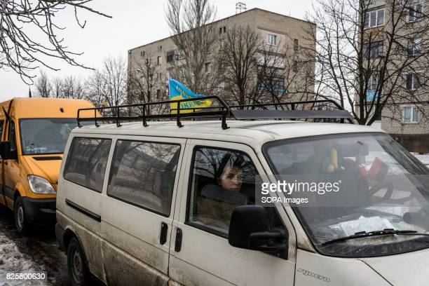 Ukrainian and Lithuanian volunteers drop off aid to a 20strong Belarusian volunteer unit who are fighting on the Ukrainian side Lithuanian volunteers...