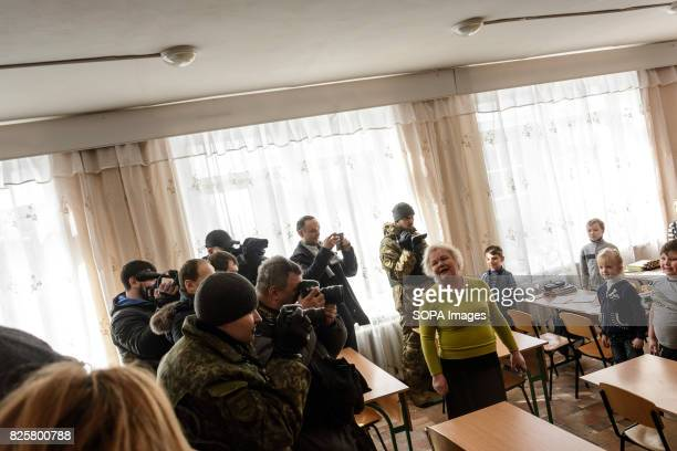 Ukrainian and military press service photographs Lithuanias foreign ministers visit in a school Lithuanian volunteers raised over 110000 euros for...