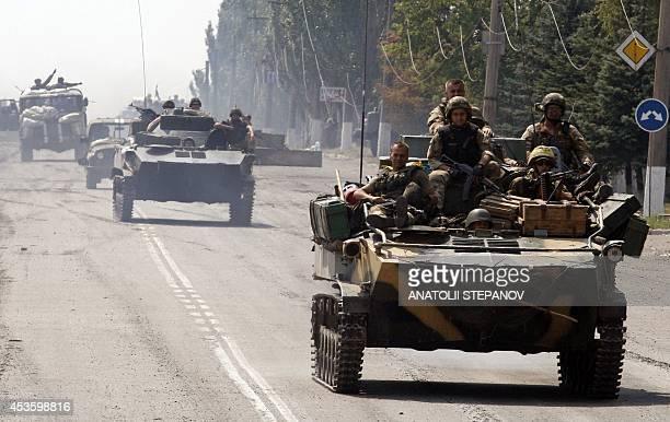 Ukrainian APCs enter the small eastern Ukrainian city of Vuglegirsk Donetsk region on August 14 freed by the country's forces three days ago Fierce...